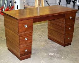 inverted walnut pedestal desk with stainless steel drawer pulls