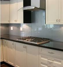 Backsplash Material Ideas - the big trend in backsplash material is glass love the color