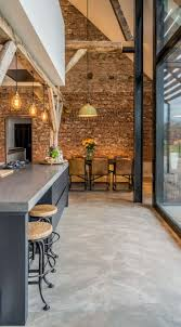 Brick Accent Wall by Converting An Old Farm Into A Warm Industrial Farmhouse With Big