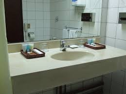 bathroom stylish single bowl sink at white concrete top floating