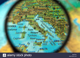 Italy On Map Italy On A Globe With The Magnifying Glass Stock Photo Royalty