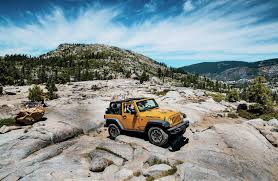 old yellow jeep boys weekend jeep wranglers on the rubicon trail