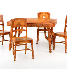 1930s art deco pioneer oak dining table with four chairs ebth