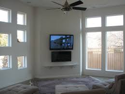 House Tv Room by Gorgeous Toshiba 55 Tv Mounted On Tile Wall In Green House Tv Over