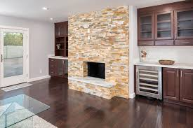 fireplace surround featuring cherry russet cabinets