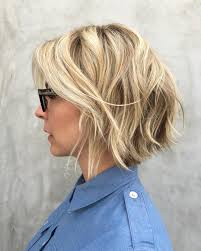 jagged layered bobs with curl 30 trendiest shaggy bob haircuts of the season