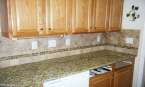 red tile backsplash kitchen granite countertop sink base cabinet red glass tiles backsplash