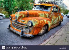 rusty car ford super deluxe 8 v8 old rusty car wreck 1947 classic parked