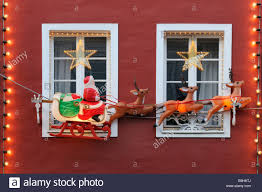 Christmas decoration Santa on sleigh drawn by reindeer on a red
