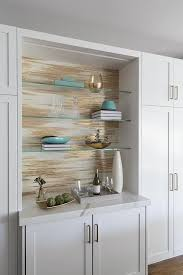 glass shelf between kitchen cabinets gray and gold metallic wallpaper is fixed stacked