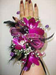 homecoming corsages you ll be the talk of the prom in this wrist corsage with purple