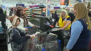 mid michigan family surprised with cart full of christmas gifts at