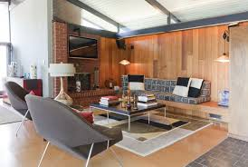 living room mid century modern with fireplace window treatments