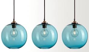 colored glass pendant light above designers bickers make their