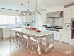 8 new york kitchen design experts share inspired ideas klaffs in this light filled kitchen of a 90 year old greenwich home designer lynne scalo incorporated oversize industrial pendants in a polished nickel to create