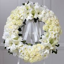 white funeral flowers and flower arrangements