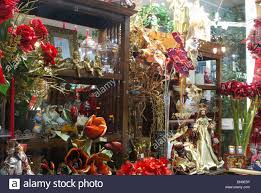 christmas decorations and flowers in a shop window fuengirola