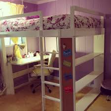 bunk beds with teenage desk under and purple painted wall also