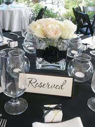 black and white centerpieces reception with black lace linens favors are ideal to end an