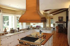 kitchen island with oven cocoa brown wooden chimney stove hood polished cocoa brown kitchen