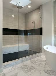 black stone tile bathroom with stainless steel and withles pull delightful soaking white porcelain tub as well as gray subway tile wall stand up shower