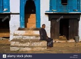 Traditional Style House by A Old Man Sits Outside His Traditional Style House In Uttarakhand