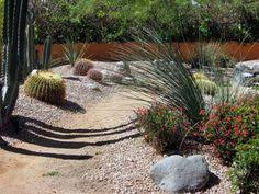 arizona desert front yard xeriscaping idea with a fake dry stream