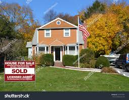 american flag pole real estate sold stock photo 229747387