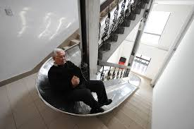 70 year old inventor zhou miaorong tries out an evacuation slide