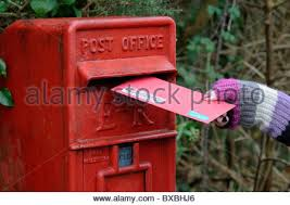 hand posting christmas cards letter in modern design uk post box