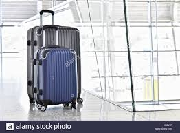suitcases two plastic travel suitcases in the airport hall stock photo