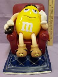 yellow peanut m u0026m candy dispenser lazy recliner chair watching tv