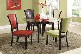 glass table black legs colorful leather chairs with black wooden legs combined with round