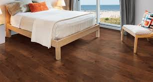 Install A Laminate Floor A Twist On A Classic Hickory With Contrasting Rich Auburn Colors