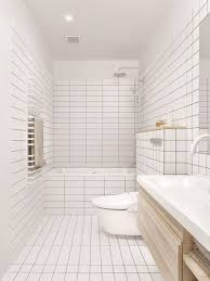 bathroom tile idea use the same tile on the floors and the walls white square and rectangular tiles cover the floor and part of the walls of this bathroom giving it a clean modern look
