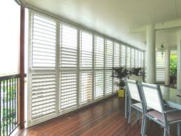 decorating laminate wood floor with plantation blinds in white