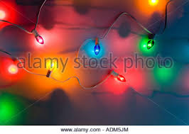 a large tree decorated with lights in front of the