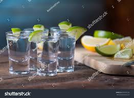 vodka tonic vodka drinks lemon lime garnish stock photo 381507520 shutterstock