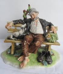 capodimonte tramp upon a bench with signed toni cingano