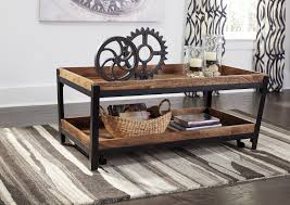 rustic industrial coffee table with iron legs and casters