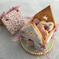 delicate icing cookie art cookie house with mini cookies