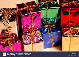 wrapped christmas boxes color image of brightly colored blue gree and pink foil