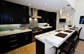 dark cabinets light countertops high back bar stools white marble