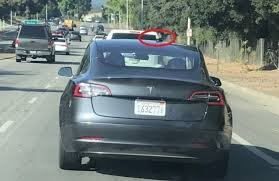 gray tesla model 3 with a camera on the top spotted in palo alto