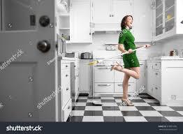 happy fun dancing housewife housekeeping kitchen stock photo