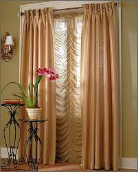 interior living room window treatment design with light brown and