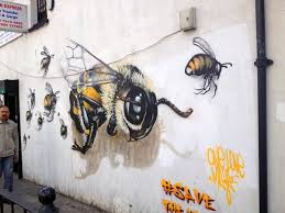 Mural Wall Art by A London Street Artist Paints Swarms Of Bees On Urban Walls To