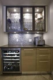 kitchen bar cabinets mini bar in the basement with slate herringbone tile starburst