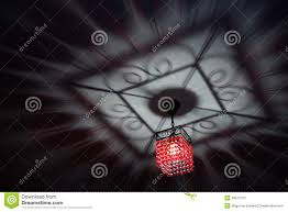 Red Chandelier by Red Chandelier Casting Chic Shadow On The Ceiling Stock Photo