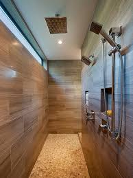 wooden paneling design with metal shower head for long narrow